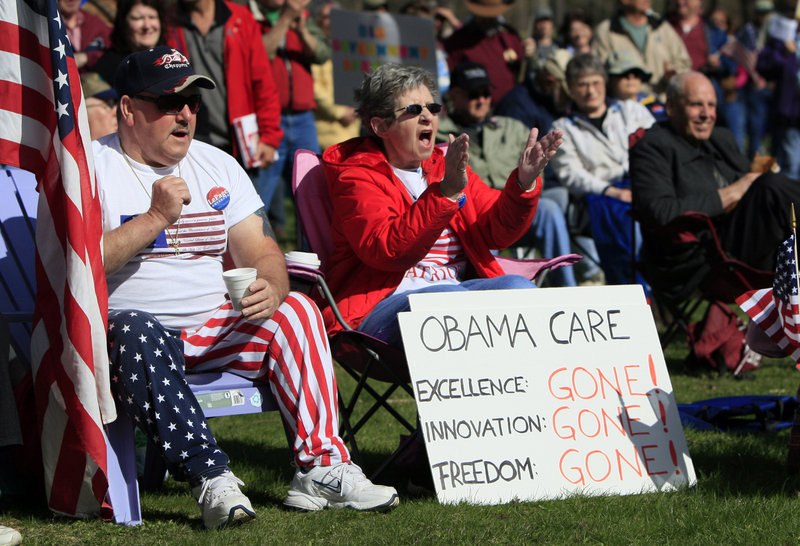 Tea party supporters cheer during a rally in Capitol Park in Augusta on April 15. Readers take different views of their cause.