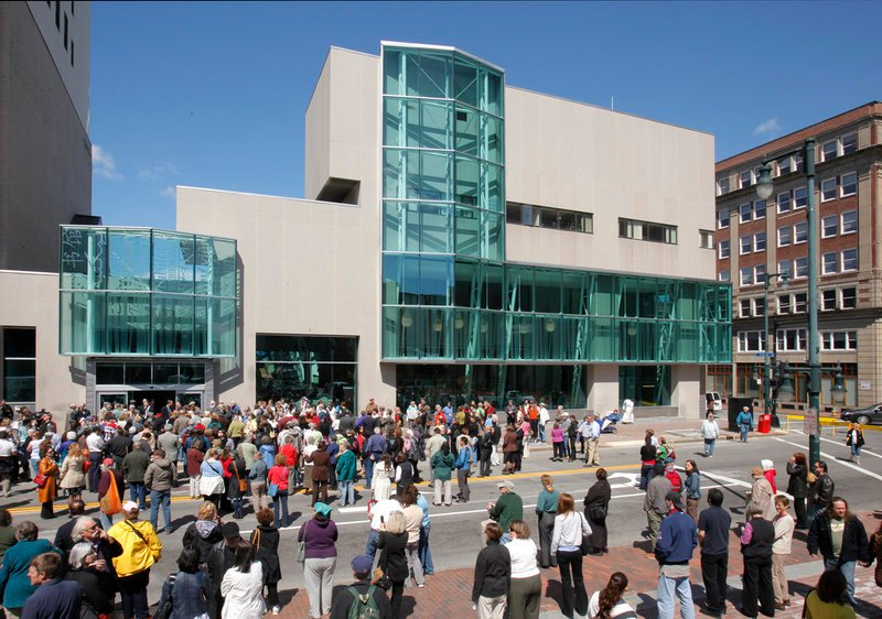 People gather on Congress Street, which was closed off for the grand reopening of the Portland Public Library's main branch April 15. Several readers said that three other branches should not be closed in order to focus on the main, Peaks Island and Burbank branches.