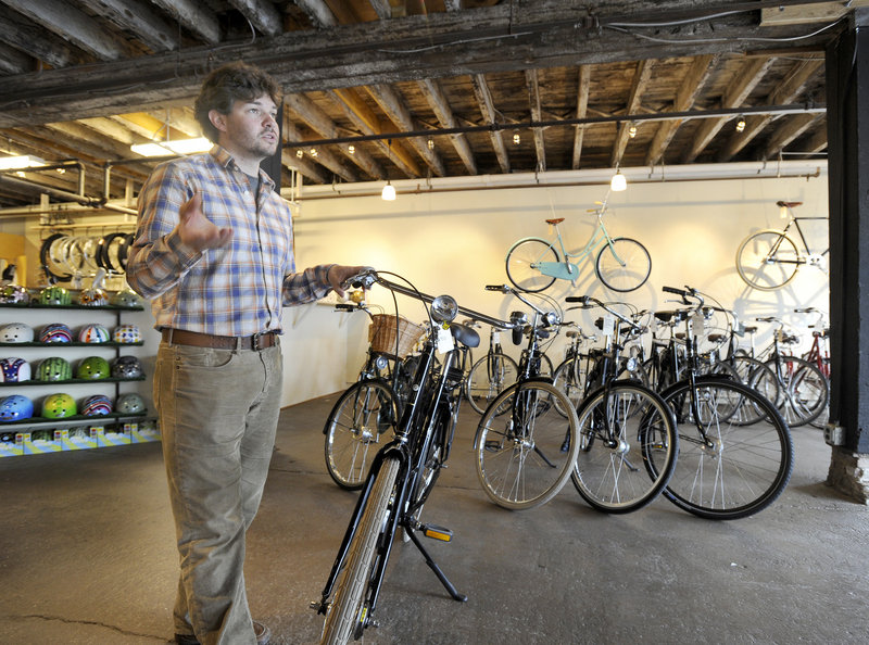 Josh Cridler, above, and Gillian Kitchings own and operate Portland Velocipede, a new bicycle shop in Portland. Their focus is on a European style of cycling – sturdier bikes designed for a comfortable ride in urban settings, as opposed to long-distance riding.
