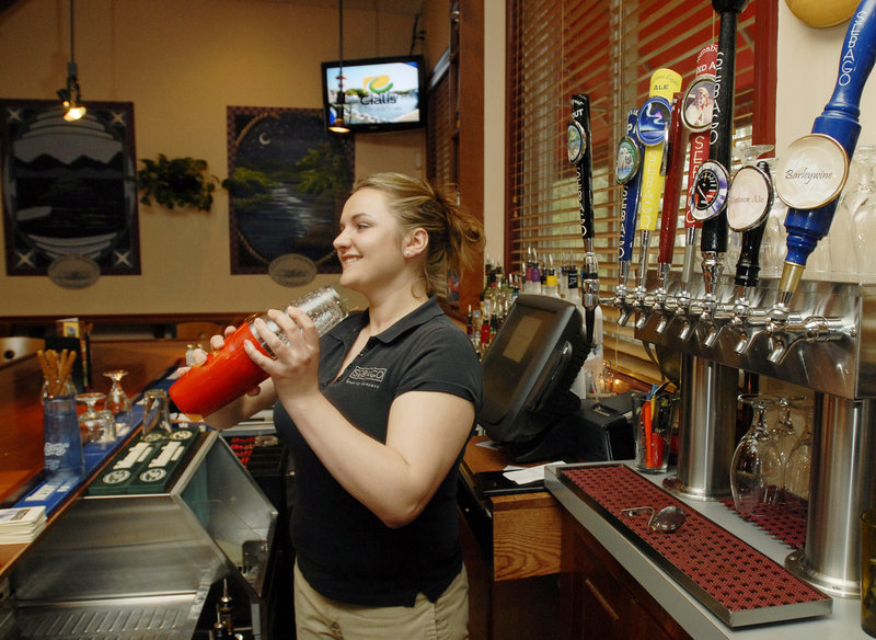 Bartender Bethany Duemmling pours drafts and mixes drinks at Sebago Brewing on Elm Street in Gorham. Especially if you're trying the beer, the smiles will come easy on the way out.