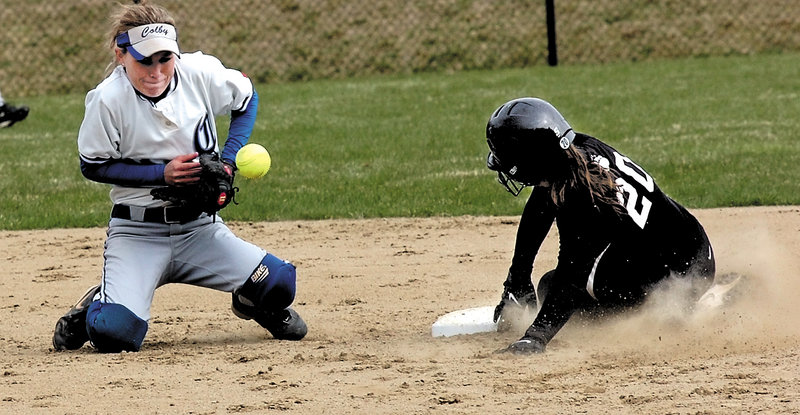 Amy Hackett of Bowdoin slides safely into second as Colby shortstop Christine Gillespie tries to field the throw Friday in Waterville. Bowdoin pulled out a 5-4 victory in 10 innings.