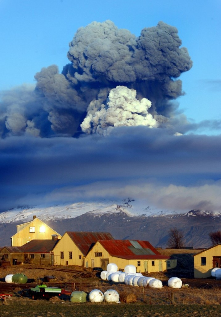 The volcano in Iceland's Eyjafjallajokull glacier sends ash skyward just before sunset Friday. Unlike ash from organic sources, this ash is a combination of small, pulverized rock and glass that can damage planes.