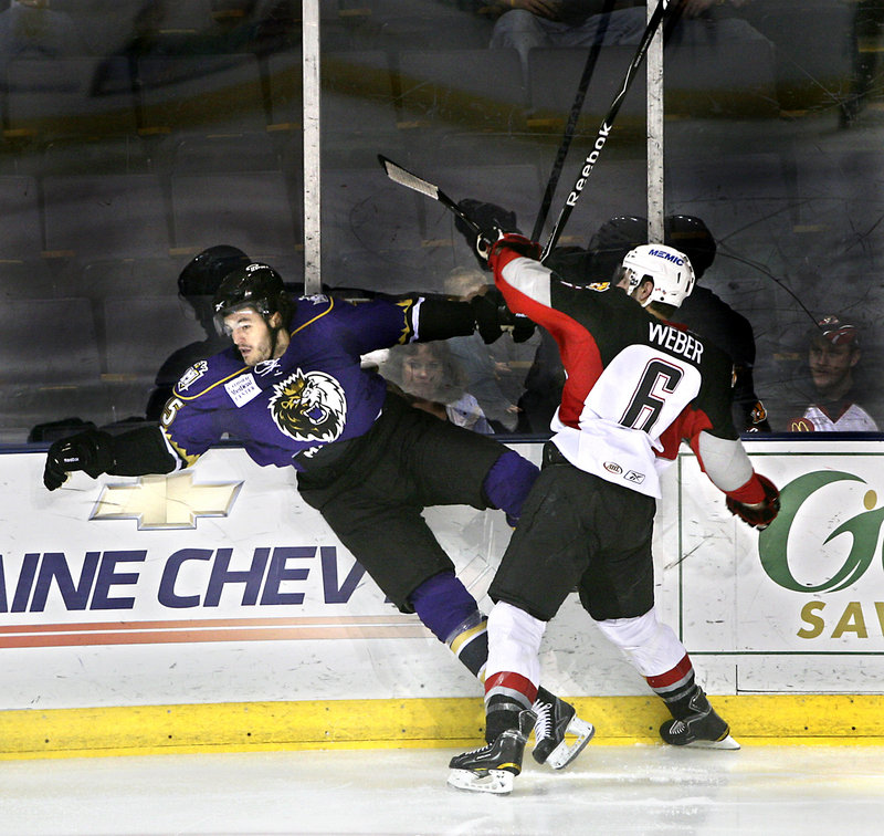 Pirates defenseman Mike Weber checks Kevin Westgarth of the Manchester Monarchs during Game 1 of their AHL playoff series Friday night at the Cumberland County Civic Center. Manchester rallied for a 2-1 win.