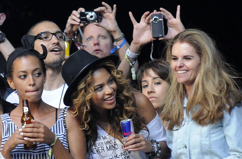 Beyonce Knowles, center, and her sister Solange, left, watch Jay Z perform with California's first lady, Maria Shriver, right, during the Coachella Valley Music and Arts Festival in Indio, Calif. Some performers were no-shows as the Iceland volacano disrupted air travel.