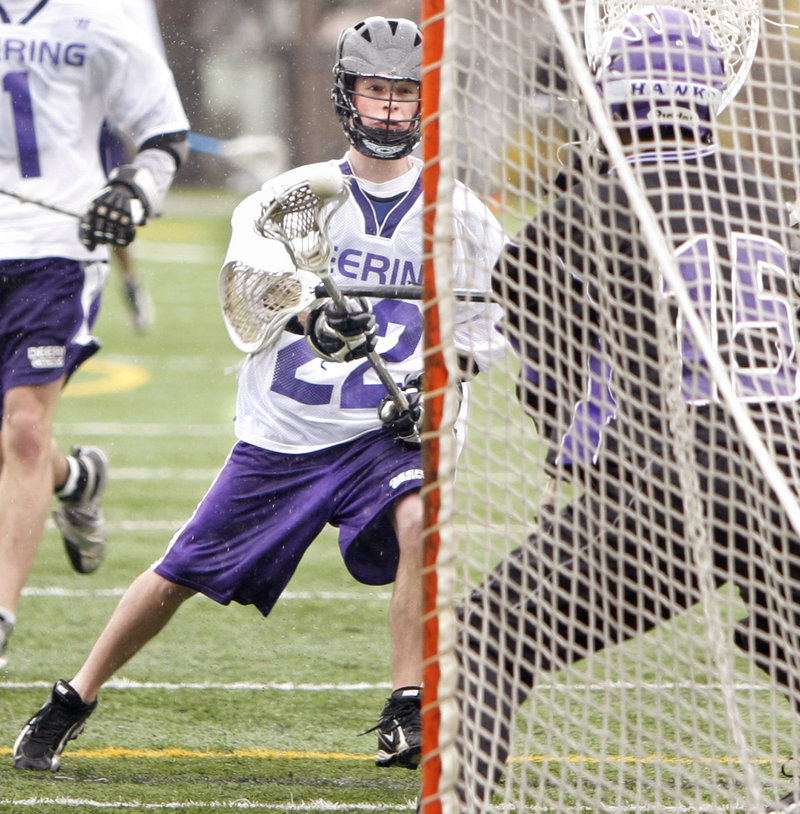 Cody Marcroft of Deering bears down on goal Saturday in the boys' lacrosse game against Marshwood. Deering dominated at home in a 16-3 victory.