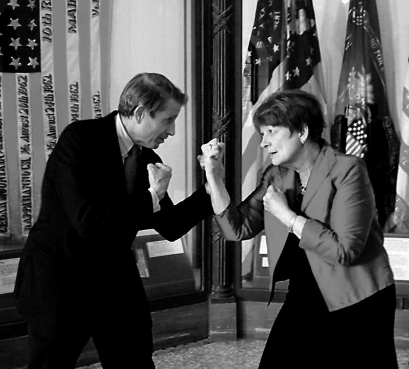 """Sen. Peter Mills and Senate President Elizabeth Mitchell have a little fun as they square off for a photo to illustrate the gubernatorial race. Mills, who's served 16 years in the Legislature, says """"state government is broken."""" Mitchell, a former speaker of the House, got into the race last August citing energy, education and health care as priorities."""