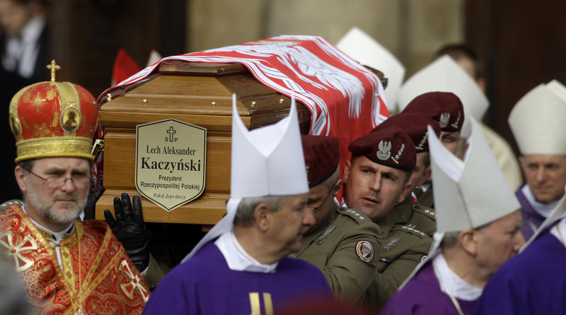 Soldiers carry the coffin of Polish President Lech Kaczynski out of St. Mary's Basilica in Krakow, Poland, on Sunday.