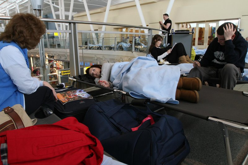 Dublin-bound passengers from Birmingham, England, wait at JFK International Airport in New York on Saturday. Airline losses have moved into the billions of dollars, and some airline officials are asking that flight restrictions caused by volcanic ash be eased.