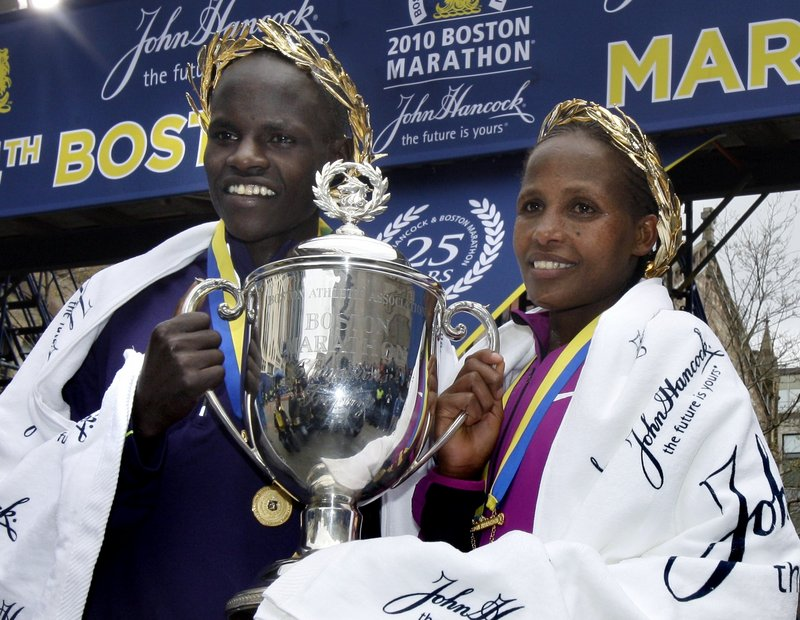 Boston Marathon men's winner Robert Cheruiyot of Kenya and women's winner Teyba Erkesso of Ethiopia celebrate Monday after the 114th running of the annual road race.