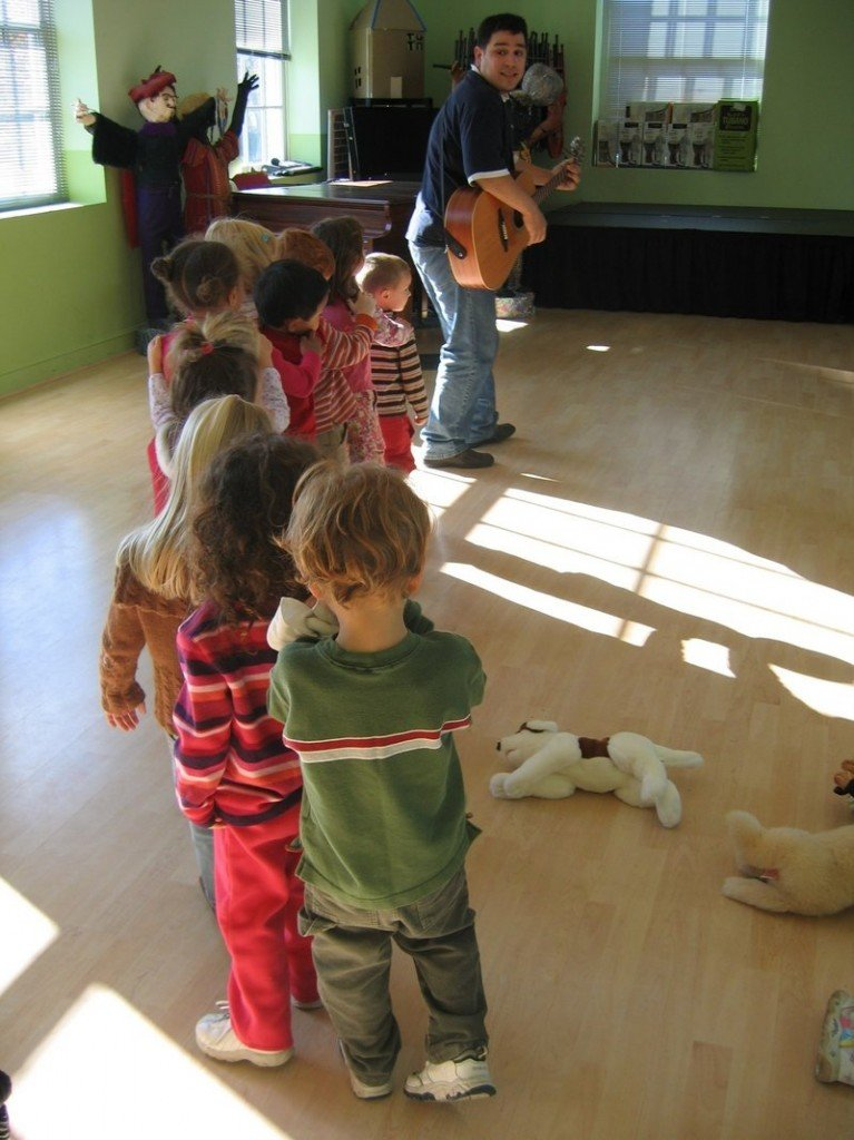 Youngsters are led in a singalong at Fiddlehead Art and Science Center in Gray. An auction to support the center will be held May 1.