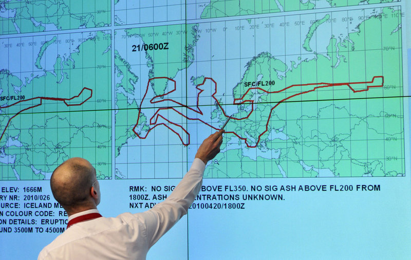 A member of the German Air Traffic Control center crisis management group near Frankfurt, Germany, points at a map showing the estimated size and direction of the volcanic ash cloud over Europe. It is expected 55 to 60 percent of flights over Europe will be flying today, but the volcano's influence could create turmoil again.