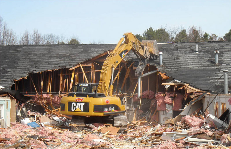 Demolition is under way at the site of the former Viking nursing home in Cape Elizabeth. Woodlands Assisted Living of Cape Elizabeth expects to open Evergreen Memory Care around October.