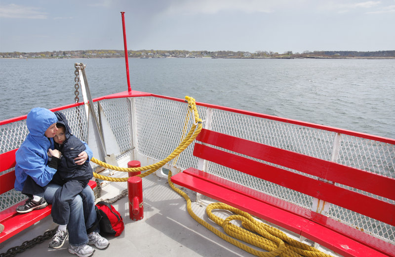 Laura Ruel and her son Curtis, 6, ride the Island Romance to Peaks Island on Wednesday. Casco Bay LInes was awarded $5.5 million to build a new ferry to replace the 65-foot vessel, but the grant is for a 110-foot boat that isn't designed to carry cars.
