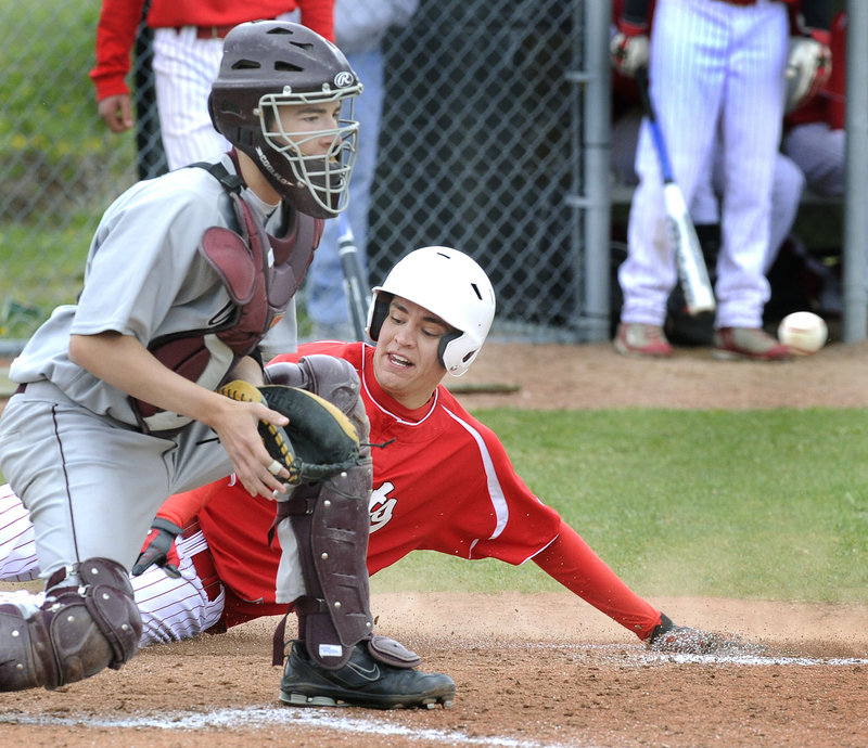 Matt Lee of South Portland slides safely across the plate as Gorham catcher Brendon Joyce waits for the throw. Friday was opening day for Telegram League baseball.