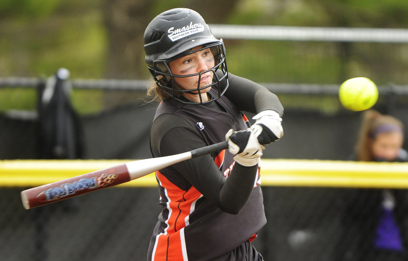 Heather Fecteau of Biddeford swings at a pitch from Deering's Kaylee Wheeler during her team's 5-0 win Friday in a softball season opener at Payson Park.