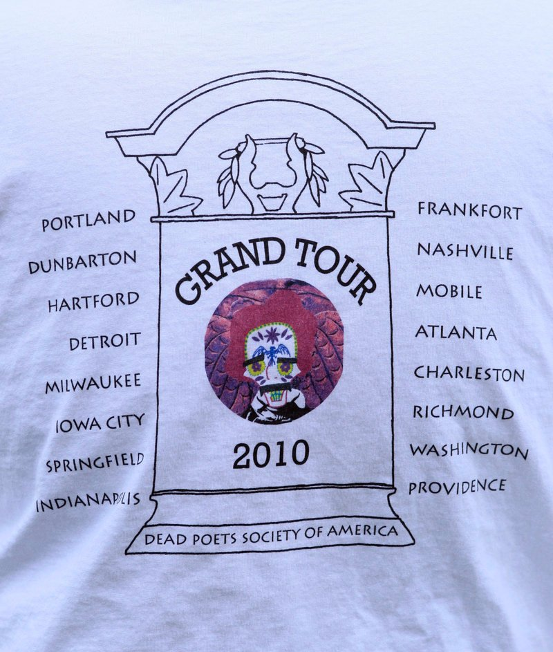 "Skold printed T-shirts listing stops on his 22-state tour of dead poet burial sites. Wisconsin poet laureate Marilyn L. Taylor says, ""I think that Walter is seeing to it that (poets) gain a little higher profile through this (tour) and also give our sincere respects to these people who have gone before us and on whose shoulders we're all standing."""