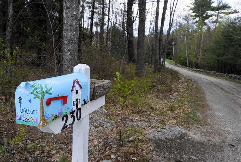 The Dolloff property on Dolloff Road in Standish, with its colorful mailbox, is shown Friday. Prosecutors say Linda Dolloff beat her husband, Jeffrey, severely with a baseball bat on April 12, 2009, then shot herself and called 911 to report a home invasion.