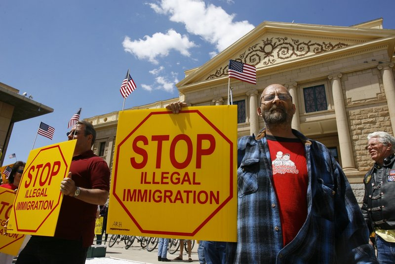 Ernie Getford holds a sign in support of an Arizona bill making it a crime not to possess proper immigration paperwork.