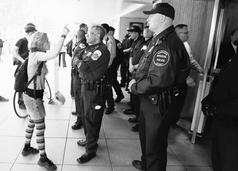 Police stand outside the World Bank doors in Washington on Friday as demonstrators protest against economic policy at the International Monetary Fund and World Bank.