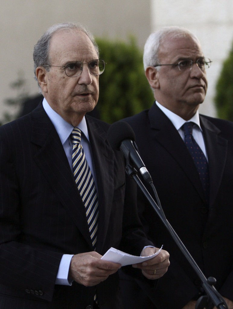 U.S. Mideast envoy George Mitchell, left, gives a statement to the press as Saeb Erekat, chief Palestinian negotiator, listens, in the West Bank city of Ramallah on Friday. Mitchell was to meet with the Israeli prime minister again today.