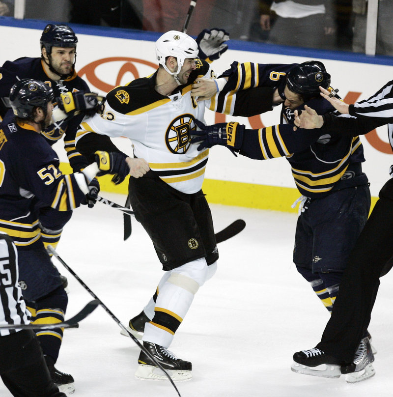 Zdeno Chara, center, the Bruins' captain, initially was suspended by the NHL because of an instigator penalty Friday in Game 5 of the series with Buffalo, but after a review, the league decided a suspension wasn't warranted.