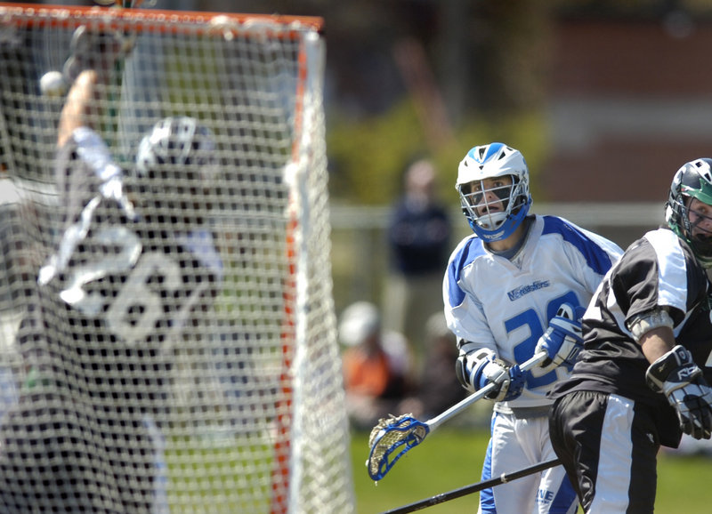 Dylan Thomas of the University of New England snaps a shot at Nichols goalie Scott Gray during a Commonwealth Coast Conference men's lacrosse game Saturday at Biddeford. Thomas had a goal and two assists in UNE's 11-1 victory.