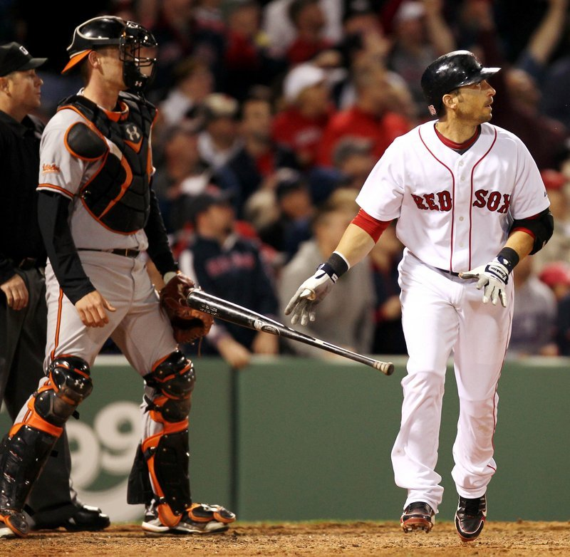 Marco Scutaro of the Boston Red Sox and Baltimore catcher Matt Wieters watch Scutaro's three-run homer in the seventh inning of a 7-6 victory Saturday night.