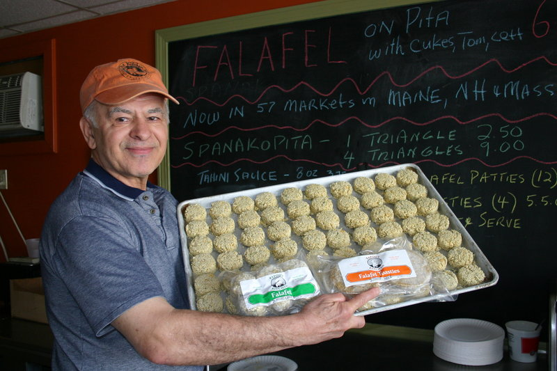 Chris Zoulamis shows off a tray of kosher-certified frozen falafels at his Papou's Kitchen facility in Portland. The company is one of a handful in Maine that have received certification from the newly formed Maine Kosher Vaad.