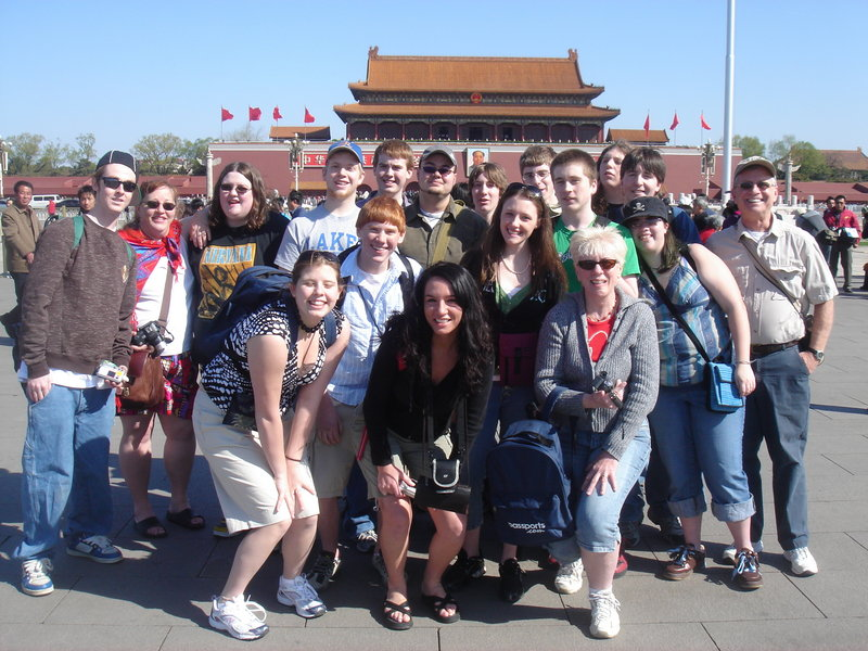 Brian Cushing, far right, poses with a group of Lake Region High School students during a 2007 trip to China. Here, the group visits Tiananmen Square in Beijing.