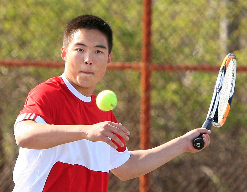 Dennis Liu returns a volley against Kurt Stultz and Nick Rallis. Both Windham and Scarborough are highly regarded this season, and they expect to meet again in the regional tournament.