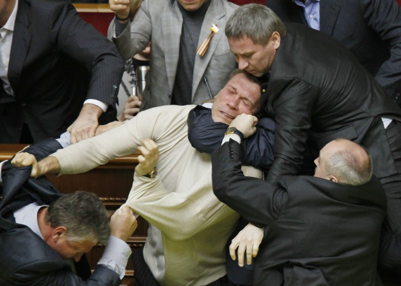 Opposition and pro-presidential lawmakers scuffle during a heated ratification vote on a Black Sea Fleet deal with Russia, at Ukraine's parliament meeting in Kiev on Wednesday.
