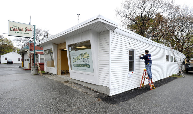 Eric Rosengren works on The Cookie Jar pastry shop on Shore Road in Cape Elizabeth. Renovations are nearly done and new equipment has been installed at the popular shop.