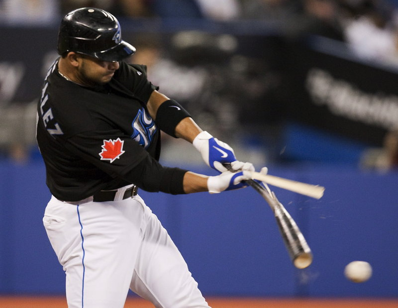Alex Gonzalez of the Blue Jays breaks his bat as he grounds out during Tuesday's game against the Red Sox at Toronto. Boston won on Mike tbases-loaded walk in the eighth.