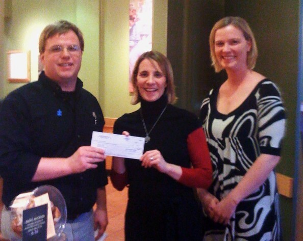Josh Montalto, of Panera Bread, left, gives a check for $2,500 to Colleen Foley-Ingersoll, REACH School director, and Lucy Lambert, the REACH School program coordinator.