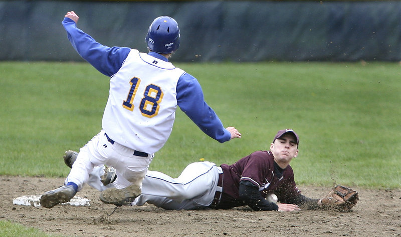 Joe Barnes of Falmouth steals second base Wednesday as Kyle Moore of Freeport stops the ball with his body. Falmouth won 11-2 in a Western Maine Conference game at Freeport that was stopped in the fifth inning because of rain.