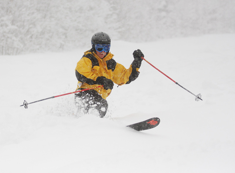 In photo taken today, a skier slaloms down one of 24 trails still open at Sugarloaf.