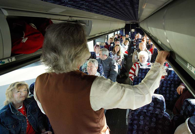 On a bus traveling to Boston on this morning, Jeff Cucci talks to Mainers traveling to a Tea Party rally where Sarah Palin was scheduled to speak to supporters. Cucci spreads his message by playing the role of Jacob Broom, a state legislator from Delaware who signed the U.S. Constitution in 1787.