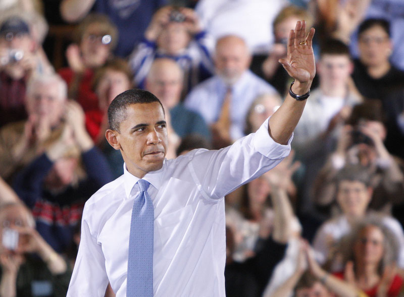 President Barack Obama waves goodbye to the crowd in Portland today after ending his speech about the health care reform law.