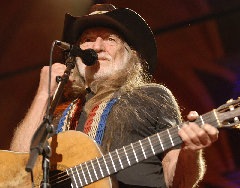 Willie Nelson performs with his band during the Farm Aid Concert in St. Louis in 2009.