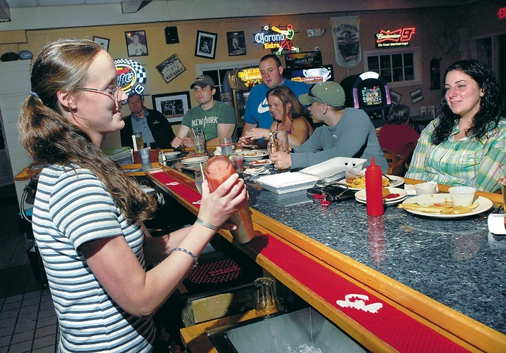 Bartender Nicole Bourgeois mixes drinks at The Landing in North Windham. Donald and Alyssa Gordon have owned The Landing for more than two years and have reinvented the atmosphere and food with a wide variety of libations and menu items.
