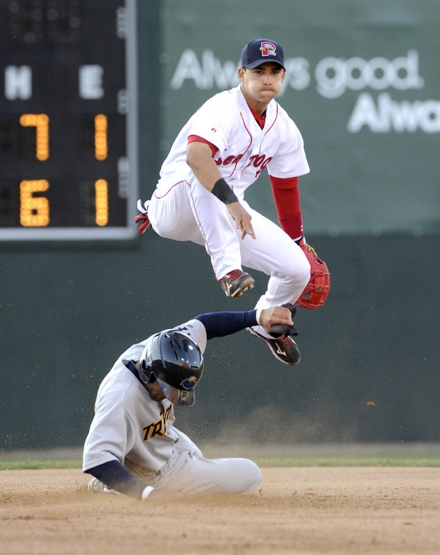 Trenton's Justin Christian slides under Portland's Jose Iglesias at second base as Iglesias completes a double play Friday night at Hadlock Field. The teams play a doubleheader May 22.