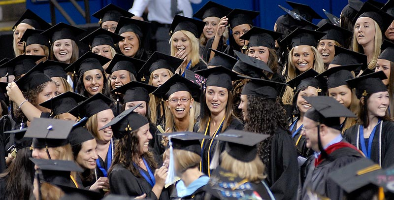 University of New England Graduates cheer as faculty members march into the Cumberland County Civic Center for Commencement today.