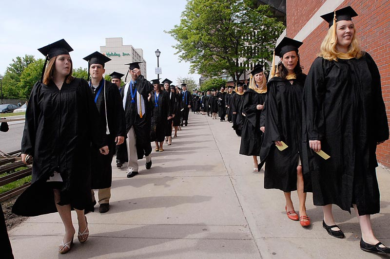 University of New England Graduates march into the Cumberland County Civic Center for Commencement today.