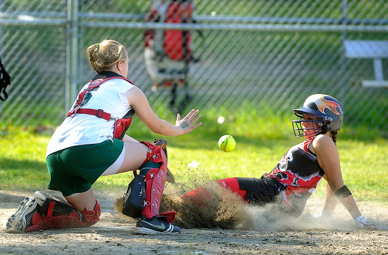 Erin Giles of Scarborough beats the throw to McAuley catcher Sam Schildroth for a three-run homer in the third inning Monday. Mo Hannan also hit a three-run homer and struck out 10 in four innings, leading Scarborough to a 15-0 victory.