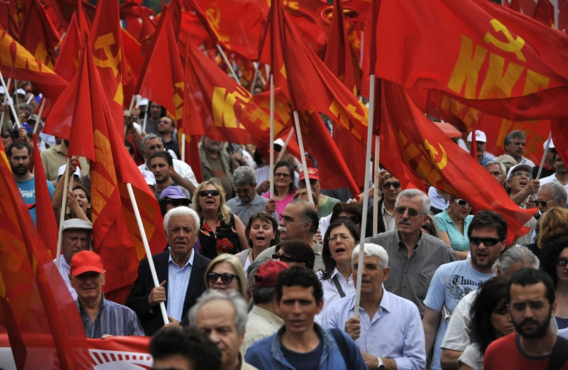 Greek Communist Party supporters shout anti-government slogans during a rally in central Athens on Saturday. The government has imposed deep cuts in wages and Greek Communist Party supporters shout anti-government slogans during a rally in central Athens on Saturday. The government has imposed deep cuts in wages and pensions and has raised taxes as part of a rescue package agreed to with the European Union and the International Monetary Fund to stave off bankruptcy.
