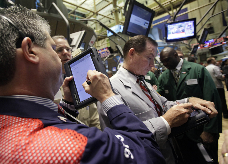 "Traders work on the floor of the New York Stock Exchange on Friday as the markets recovered some of the ground lost Thursday when the Dow dropped 376 points. With this week's roller-coaster ride and the ""flash crash"" of two weeks ago, investors are struggling to make sense of all the factors whipsawing the markets."