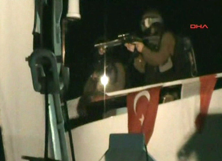 This video image released by the Turkish Aid group IHH today purports to show Israeli soldiers aiming a gun on the deck of a Turkish ship, part of an aid convoy heading to the Gaza Strip, after Israeli soldiers boarded the vessel in international waters. Israeli commandos on Monday stormed six ships carrying hundreds of pro-Palestinian activists on an aid mission to the blockaded Gaza Strip, killing at least 10 people and wounding dozens after encountering unexpected resistance as the forces boarded the vessels.