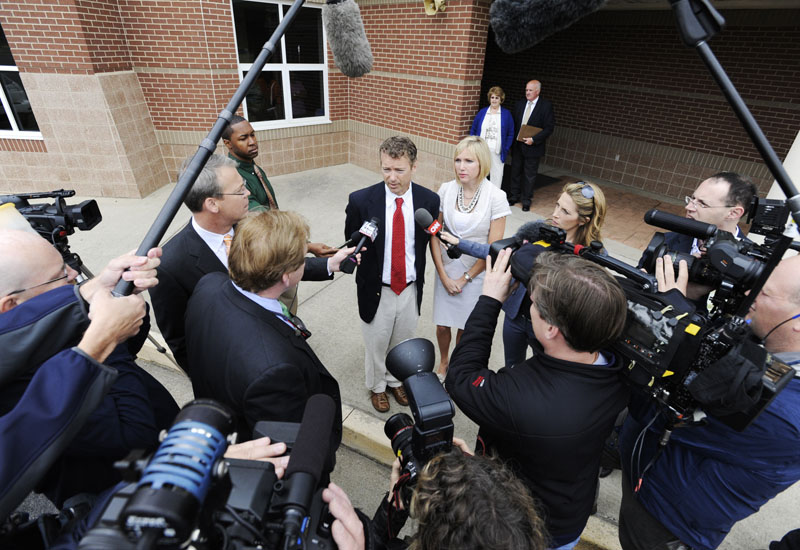 Republican U.S. Senate candidate Rand Paul and his wife Kelley Paul speak with the media after voting in Bowling Green, Ky. Tuesday. Paul defeated fellow Republican Trey Grayson in the primary election.