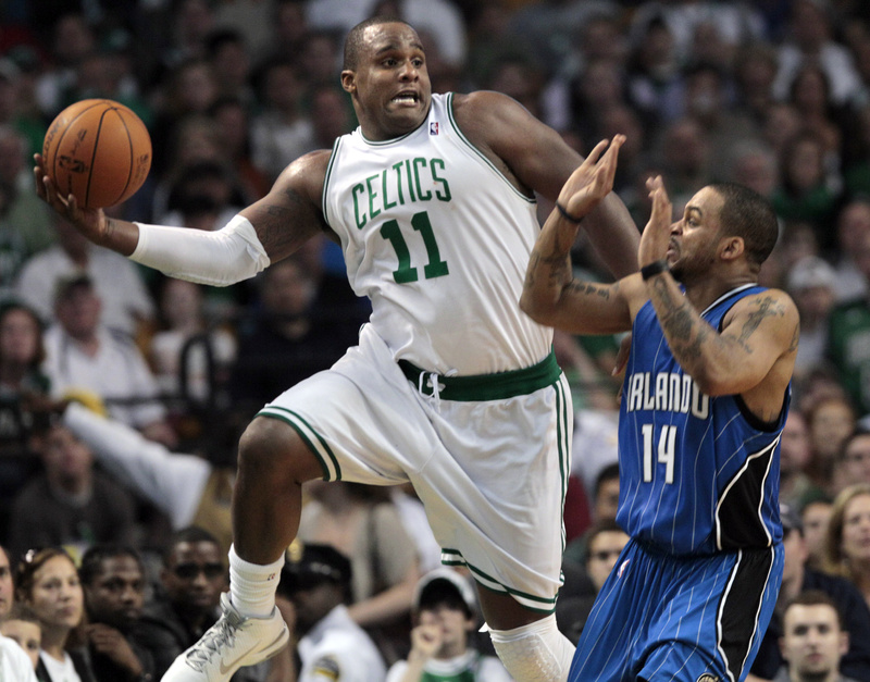 Boston Celtics forward Glen Davis saves the ball from going out of bounds as Orlando Magic guard Jameer Nelson reacts during the first half of Game 3 of the NBA Eastern Conference basketball finals in Boston on Saturday.