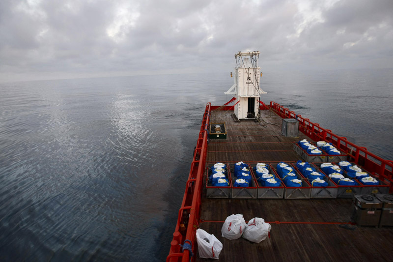 With a sheen of oil as far as the eye can see, the Joe Griffin arrives today at the rig explosion site carrying the containment vessel that will be used to try to contain the Deepwater Horizon oil.